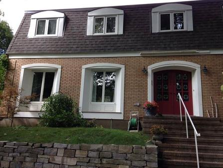 painting of exterior of house white paint on windows with red paint on front door painting by ottawa painters PG Paint & Design