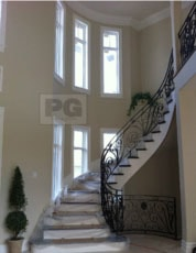 painting of entrance and foyer with large stairway of house in Ottawa by PG PAINT & DESIGN painters