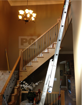 interior painting of hallway entrance with high ceilings by PG PAINT & DESIGN house painters