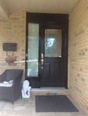 painting of exterior front entrance door in black paint colour