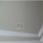 painting of wood trim and crown moulding details on ceiling