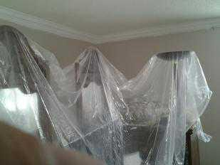 Furniture Covered With plastic before interior painting services from PG PAINT & DESIGN Ottawa House Painters