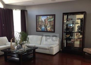Living Room with Painting hanging on the wall