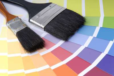 two paint brushes with paint colour samples