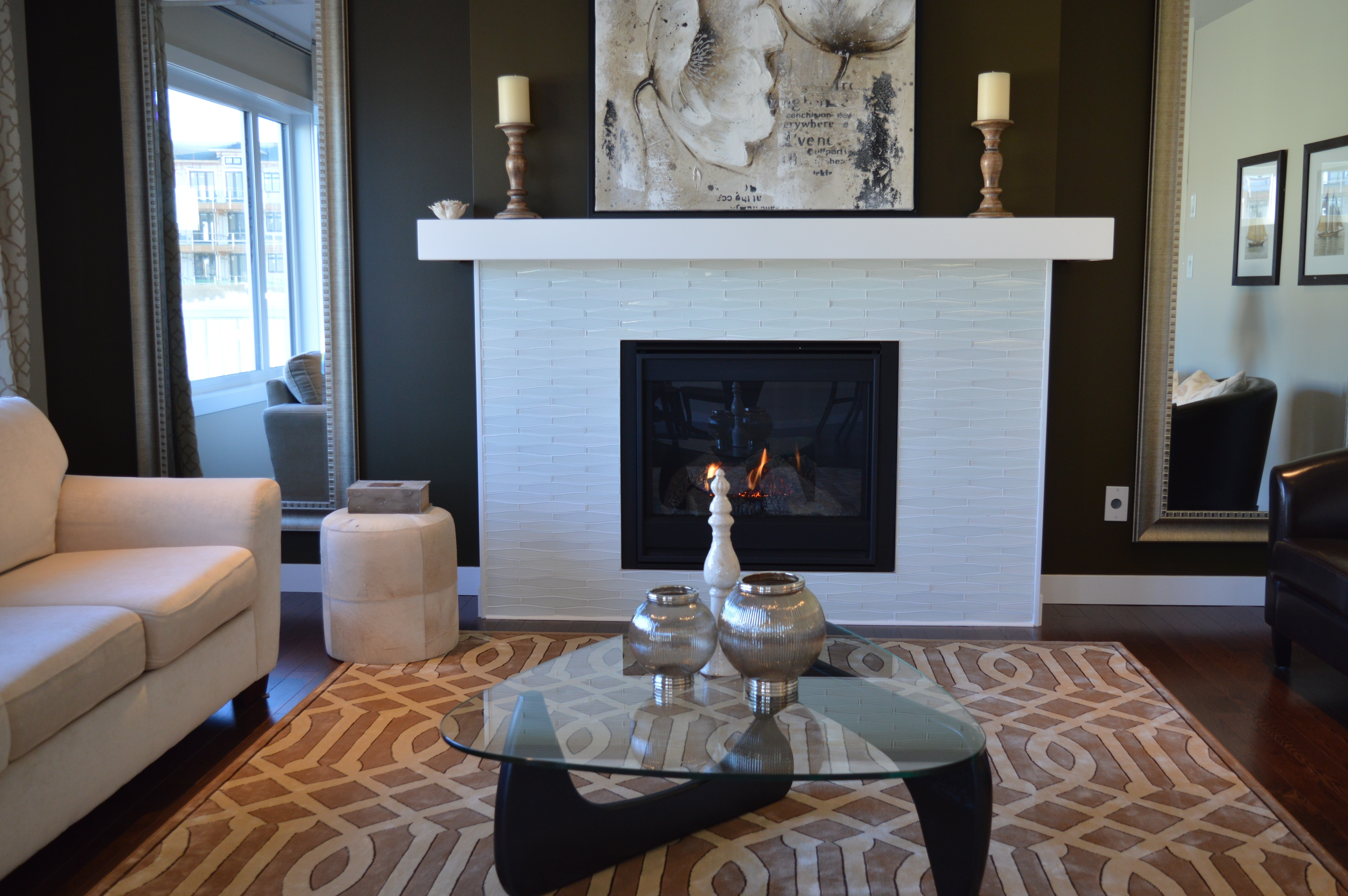 house painting services in Ottawa by PG PAINT & DESIGN  professional painters living room with black paint colour, white fireplace, sofa, rug and coffee table