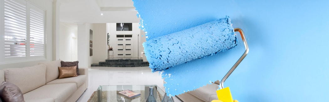 paint roller with blue paint painting wall by PG Paint & Design Ottawa House Painters