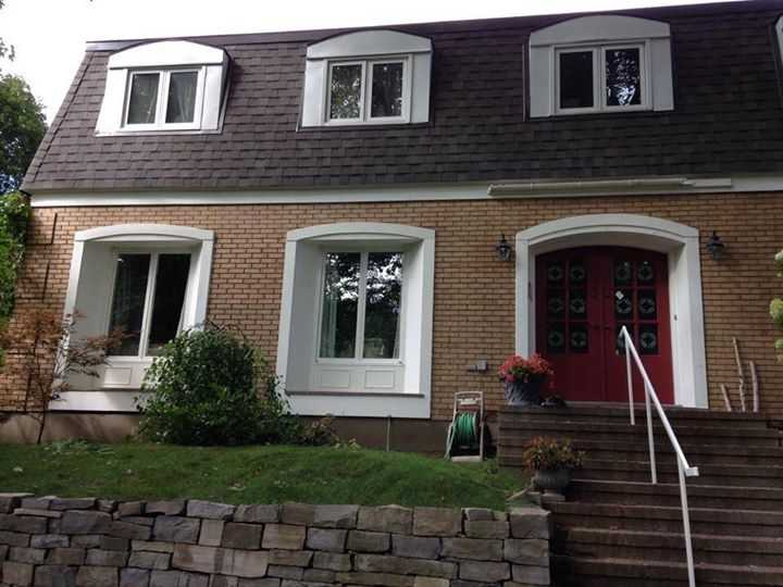 painting of exterior windows in white paint and red door with brick on house in Ottawa by painters PG PAIINT & DESIGN