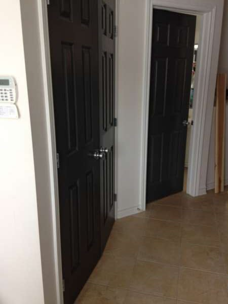 interior painting of black doors and entrance hallway of Orleans, Ontario home by painters PG PAINT & DESIGN