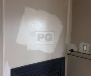 patched drywall repair of interior wall before painting