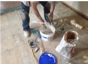 mixing drywall compound for repairs before painting