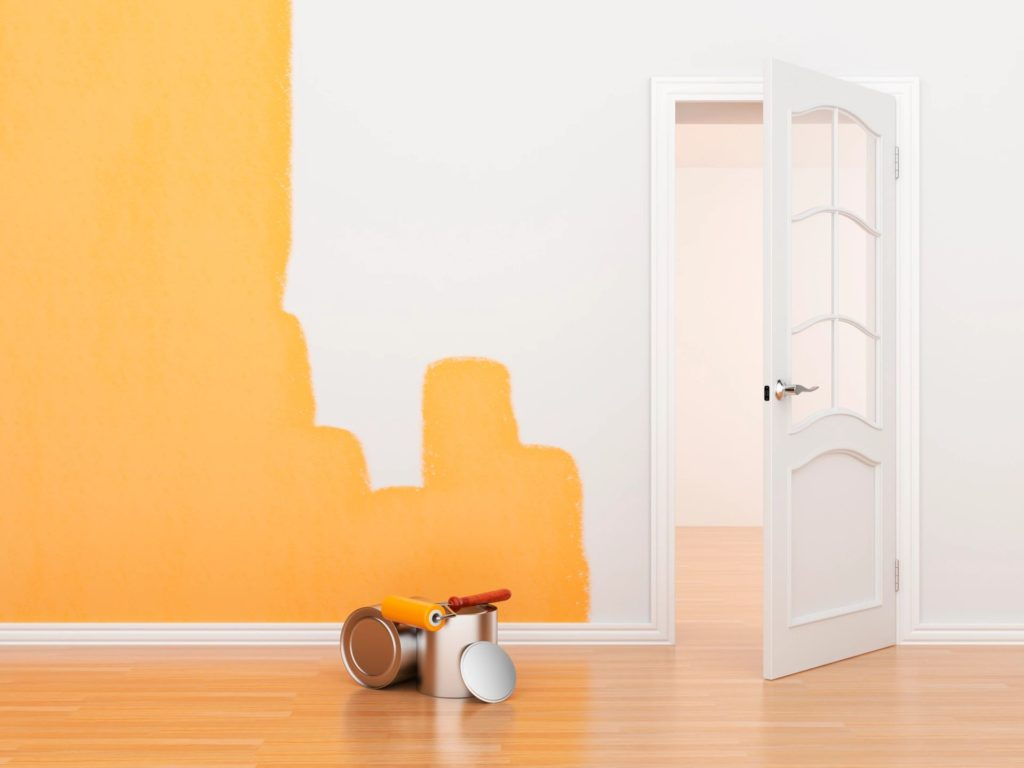 interior painting of walls with yellow paint colour