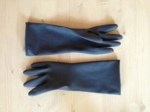 black pair of rubber gloves to be used to remove mold from ceiling or walls
