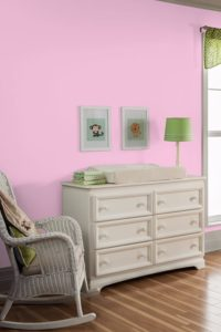 Pink paint on walls in nursery baby room
