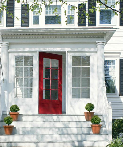 painting red paint colour on front door entrance exterior