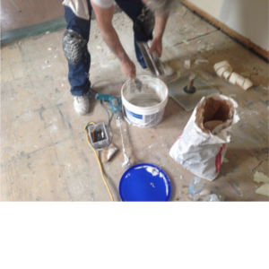 mixing of drywall compound to repair and patch walls and ceilings before painting