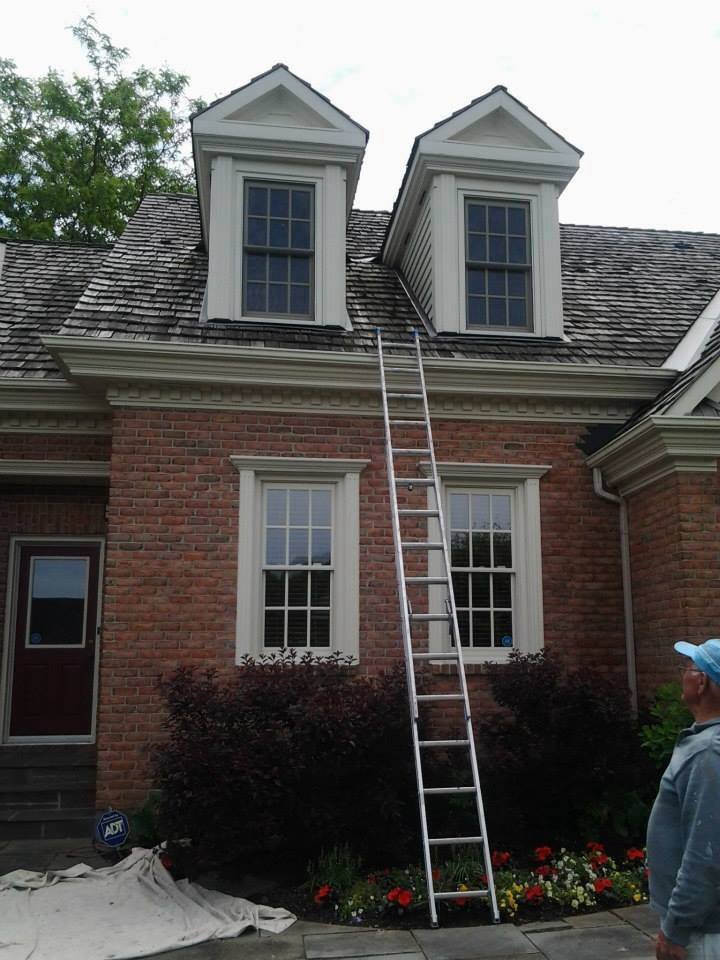 an exterior painting of house by PG PAINT DESIGN in Manotick area Ottawa
