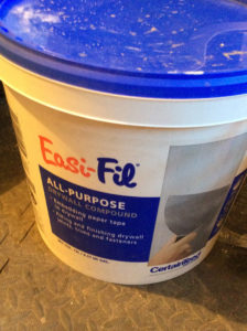 bucket of easi fil all purpose drywall compound used by professional painters