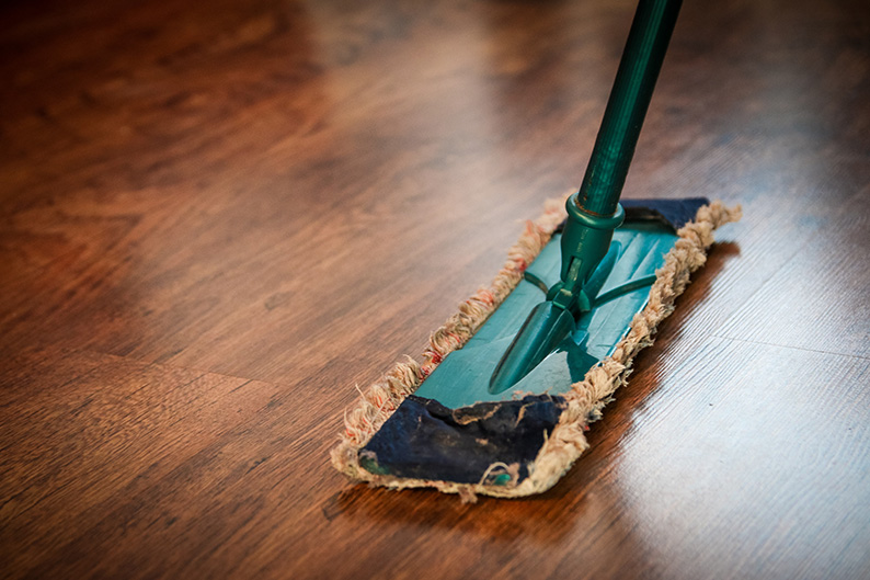cleaning hardwood floor with a mop