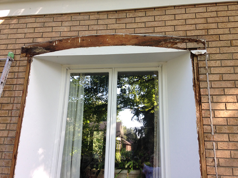 replacing wood around exterior windows of house and painting after repair by PG PAINT & DESIGN painters in Ottawa