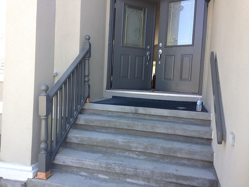 exterior painting of stairs railing and front door of house painted by PG PAINT & DESIGN Professional House Painting company in Ottawa