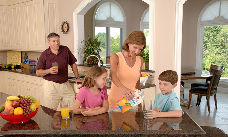 family in the kitchen of their painted house