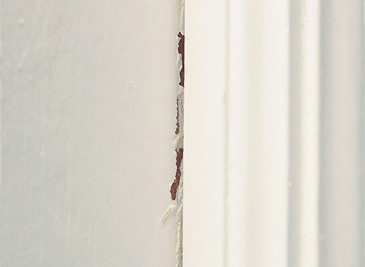 cracking or breaking paint at joint of wall and trim work
