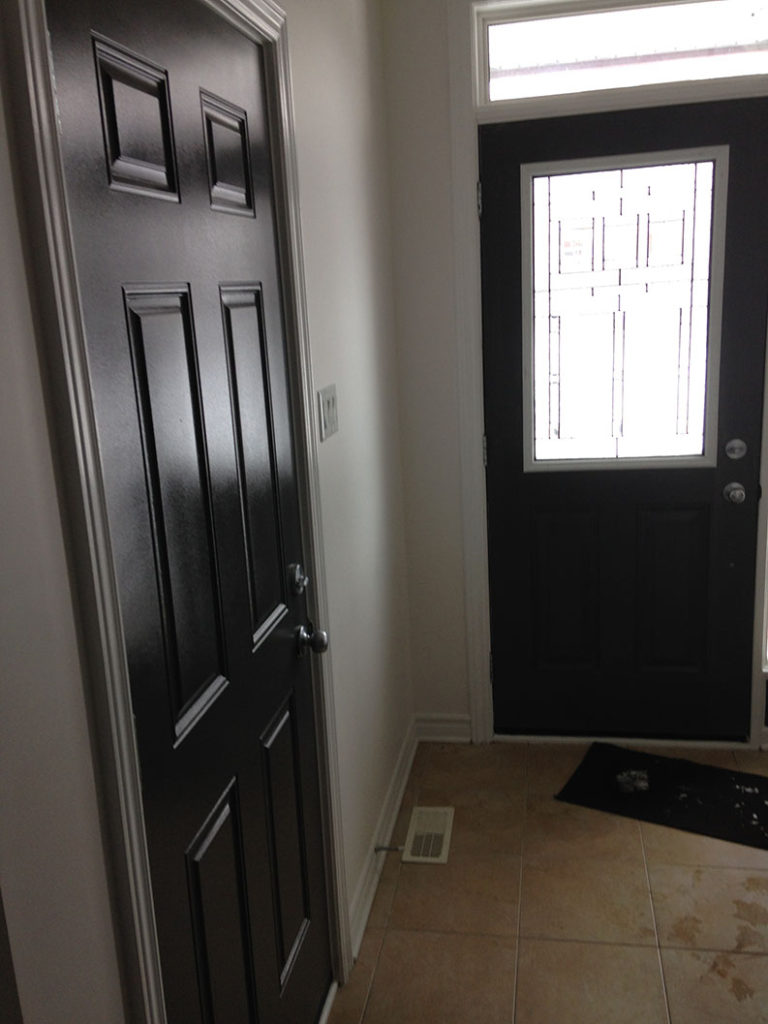 painting of doors in dark paint color painted by PG PAINT & DESIGN painting company in Ontario Ottawa