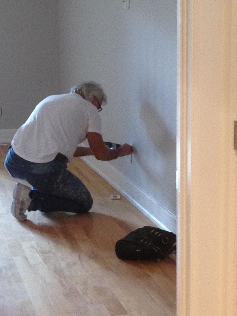 PG PAINT & DESIGN painter repairing walls before painting
