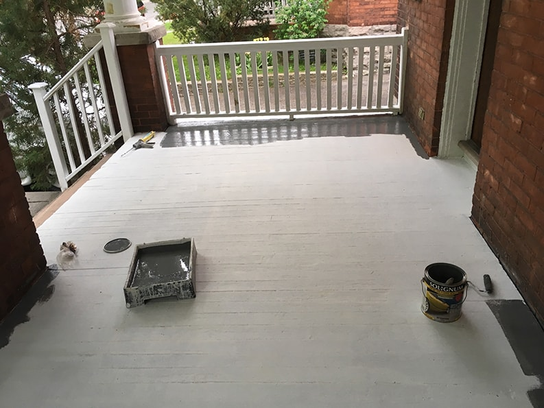 primer paint and first coat of exterior paint is applied to wood on front porch veranda by PG PAINT & DESIGN