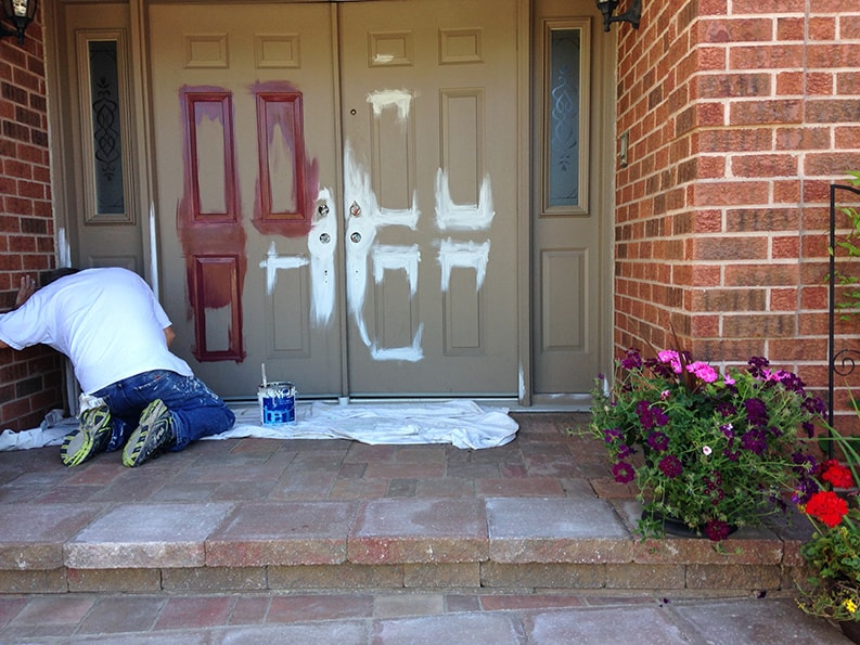priming of exterior entrance doors to house on Windermere way off of Prince of wales drive