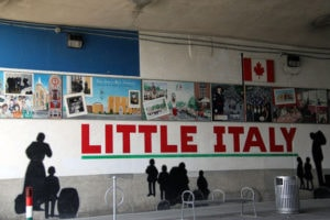 text as little Italy painted by PG PAINT & DESIGN under the bridge
